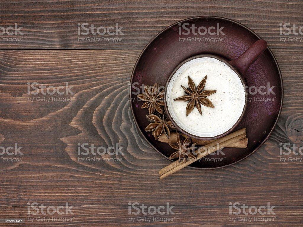 Herbal chai tea with milk stock photo
