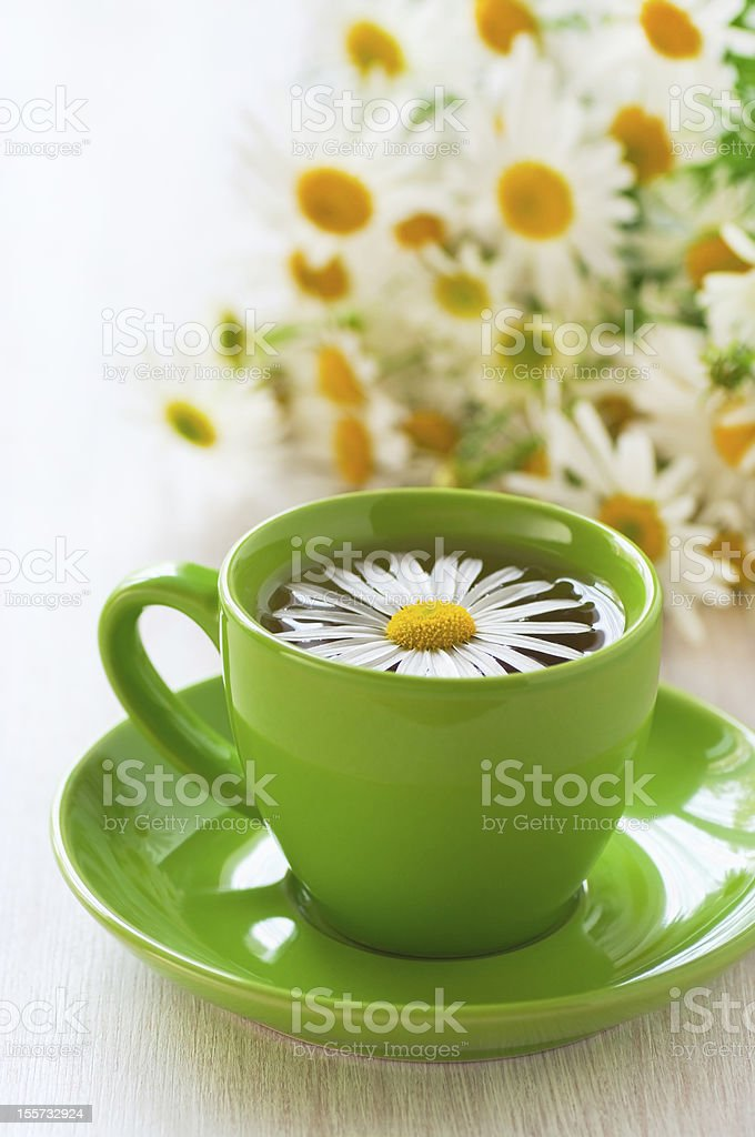Herbal chamomile tea in a green cup royalty-free stock photo