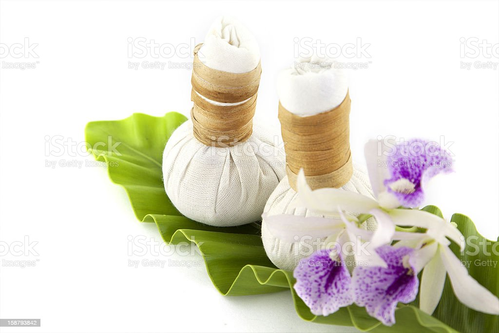 herbal compress with orchid flower on white background royalty-free stock photo