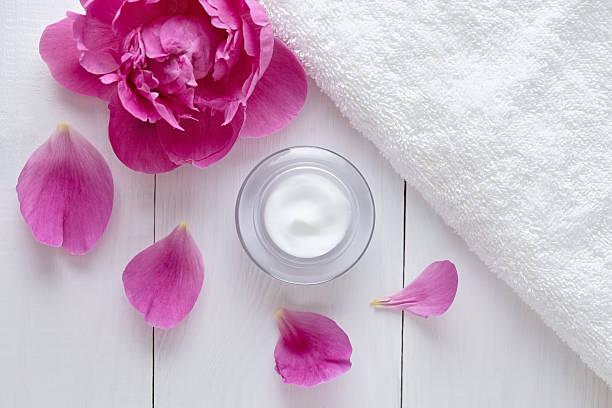 Herbal cosmetic acne cream with flowers vitamin skincare organic moisturizer stock photo
