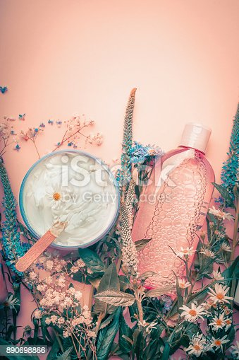 istock Herbal dermatology cosmetic cream and lotion with flowers . Skincare products 890698866