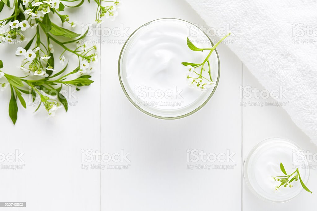 Herbal face cosmetic cream with flowers hygienic skincare product stock photo