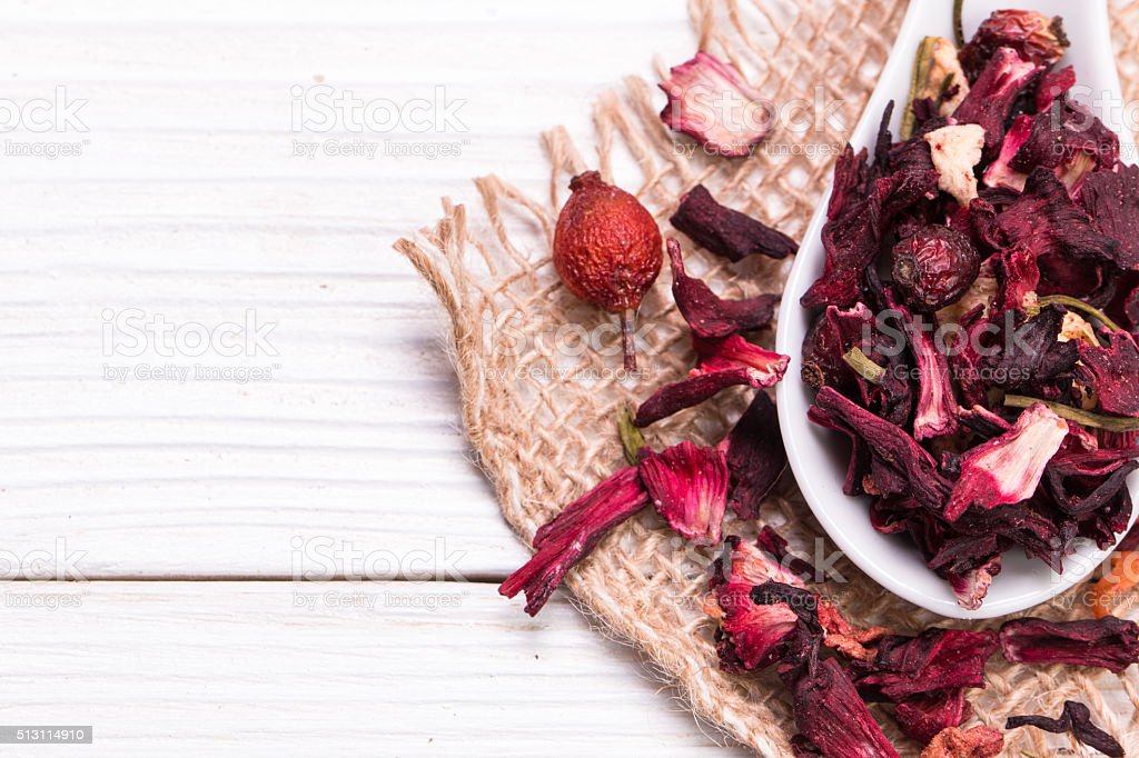 herbal floral fruit tea with petals, dry berries and fruits. stock photo