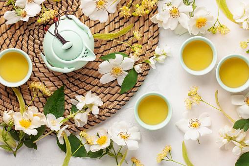 istock Herbal healthy tea with flowers of jasmine, linden and rosehips. Top view 1266714449