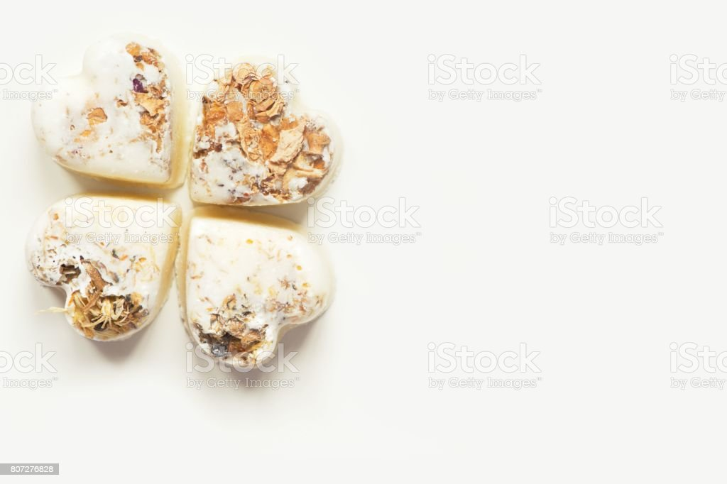 Herbal heart bath bombs on a white background. Copy space stock photo