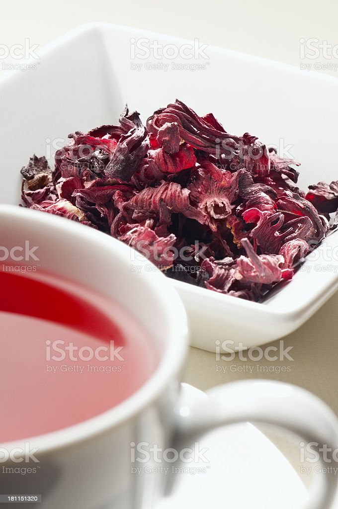 Herbal hibiscus rose-hip tea leaves and cup of tea stock photo