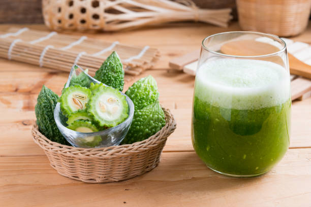 Herbal juice of green momodica , Balsam apple, Balsam pear, Bitter cucumber , Bitter gourd stock photo