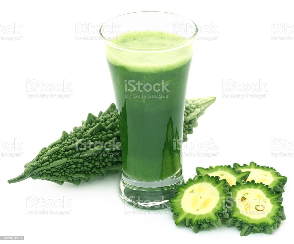 Herbal juice of green momodica stock photo