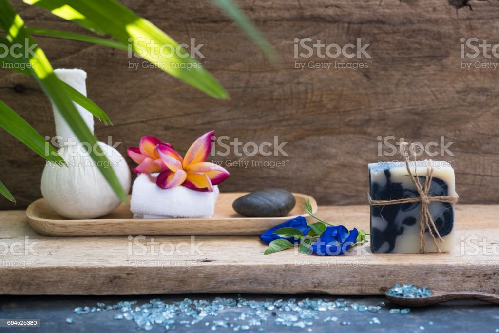Herbal massage ball and indigo soap spa aromatherapy products royalty-free stock photo