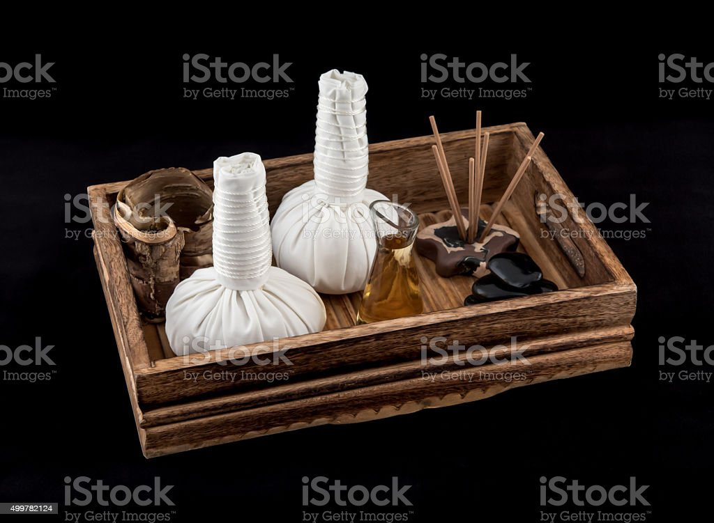 Herbal Massage Balls and Aromatic Massage Oil stock photo