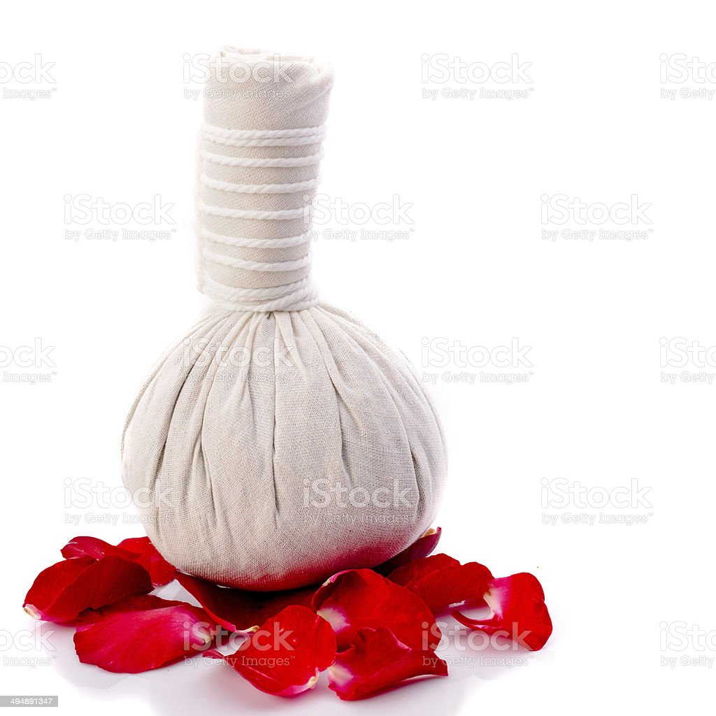 Herbal massage balls and red rose isolated on white. royalty-free stock photo