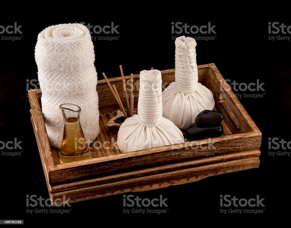Herbal Massage Balls with Massage Oil and Towel stock photo