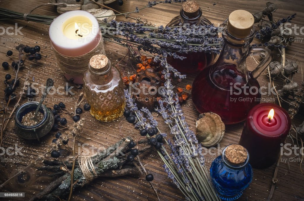 Magic potion. Alternative herbal medicine. Shaman table with copy...
