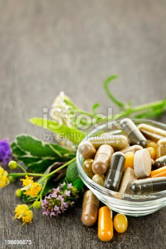 Herbs with alternative medicine herbal supplements and pills