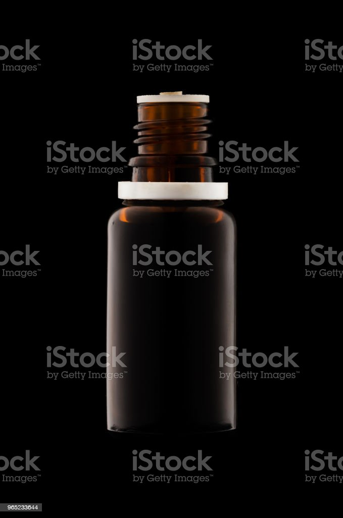 Herbal medicine or aromatherapy dropper bottle isolated on black background royalty-free stock photo