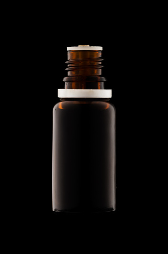 Herbal Medicine Or Aromatherapy Dropper Bottle Isolated On Black Background Stock Photo & More Pictures of Amber