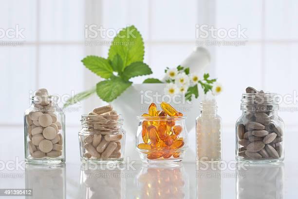 Herbal medicine pills and mortar over bright background picture id491395412?b=1&k=6&m=491395412&s=612x612&h=mtynbgiocckarqymuwxubnnvsilrfcprobbtxjs0op0=