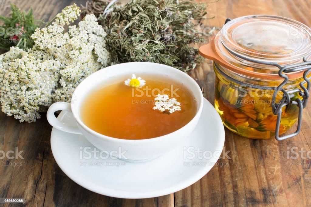 Herbal Medicine, Tea, Yarrow, Savory, Chamomile and Calendula Oil stock photo