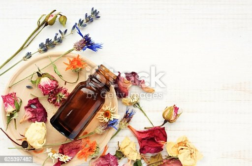 istock Herbal pharmacy.Botanical cosmetic ingredients, aromatherapy background. 625397482