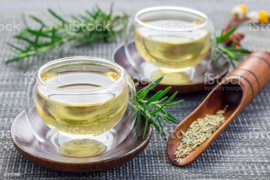 Herbal rosemary tea in a glass cup on oriental background, horizontal photo libre de droits