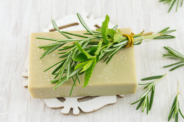 Herbal soap with rosemary and mint leaves