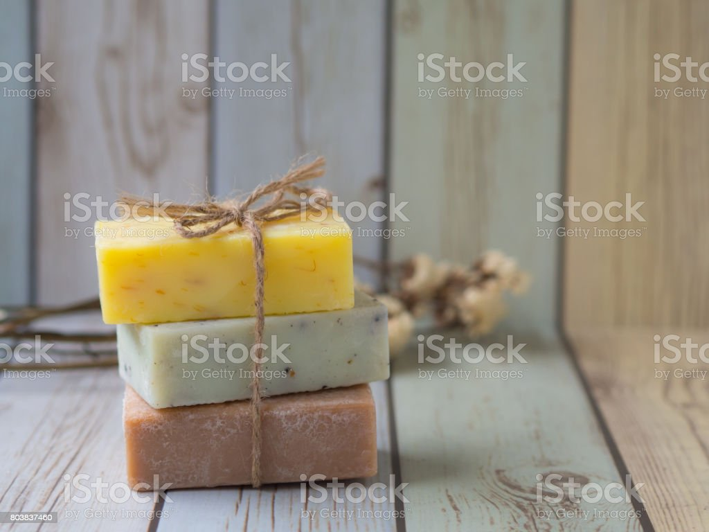 Herbal soaps on pastel colour wood table stock photo