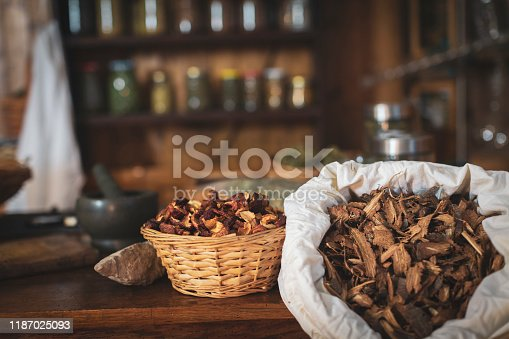 Herbal Store with Dried Apple, Oak Bark and Herbs in Background - Stock Photo