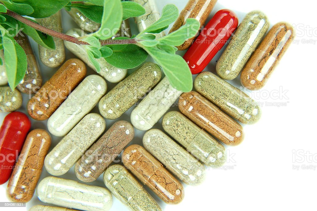 herbal supplement capsules isolated on white stock photo