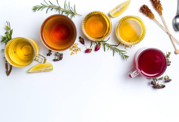 herbal tea collection glasses on white background - herbata ziołowa zdjęcia i obrazy z banku zdjęć