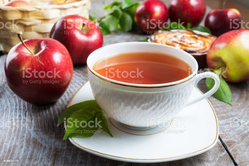 Herbal tea cup and apple pie stock photo