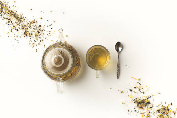 herbal tea in cup and kettle stock photo