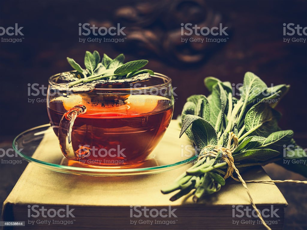 Herbal tea made from sage in glass cup stock photo