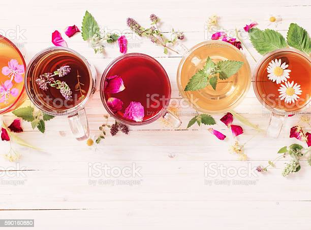 Herbal tea on a white wooden background picture id590160880?b=1&k=6&m=590160880&s=612x612&h=lds4phmqa99vvxxssxrql1empv5snyl xpoiyupbnoo=