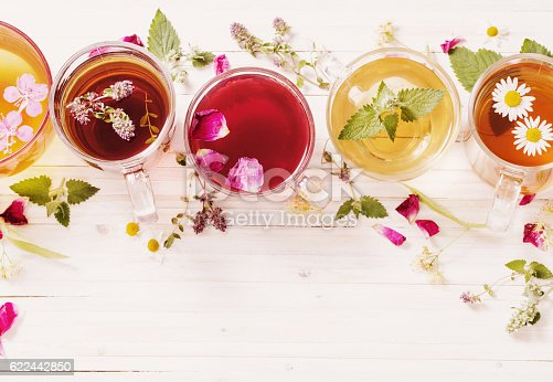 istock herbal tea on a white wooden background 622442850