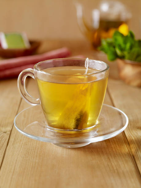 Herbal tea Glass ofHerbal tea on cafe table greentea stock pictures, royalty-free photos & images