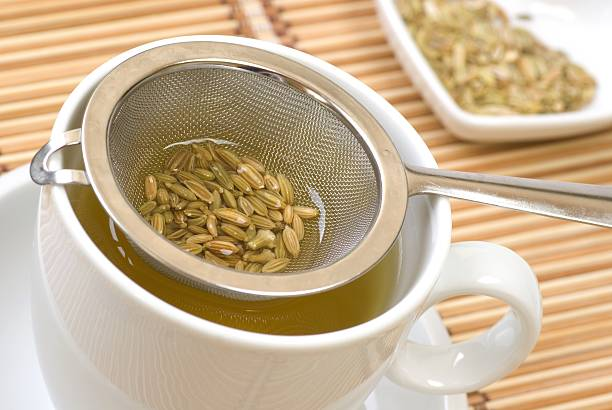 Herbal tea Fennel tee and seeds. fennel stock pictures, royalty-free photos & images