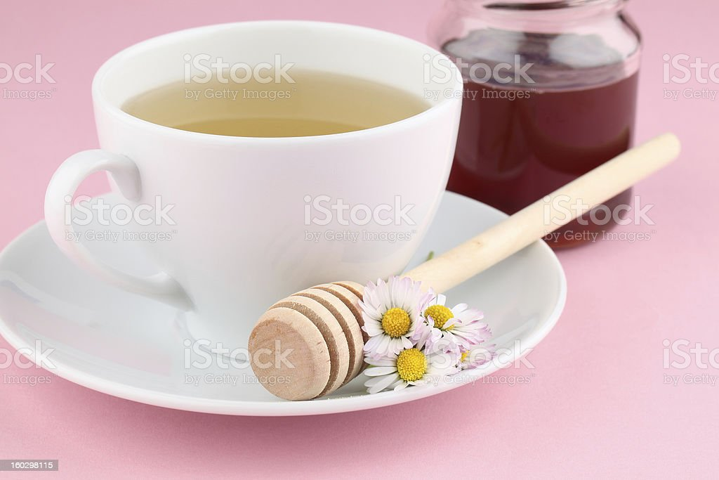 Herbal tea with daisies and honey royalty-free stock photo