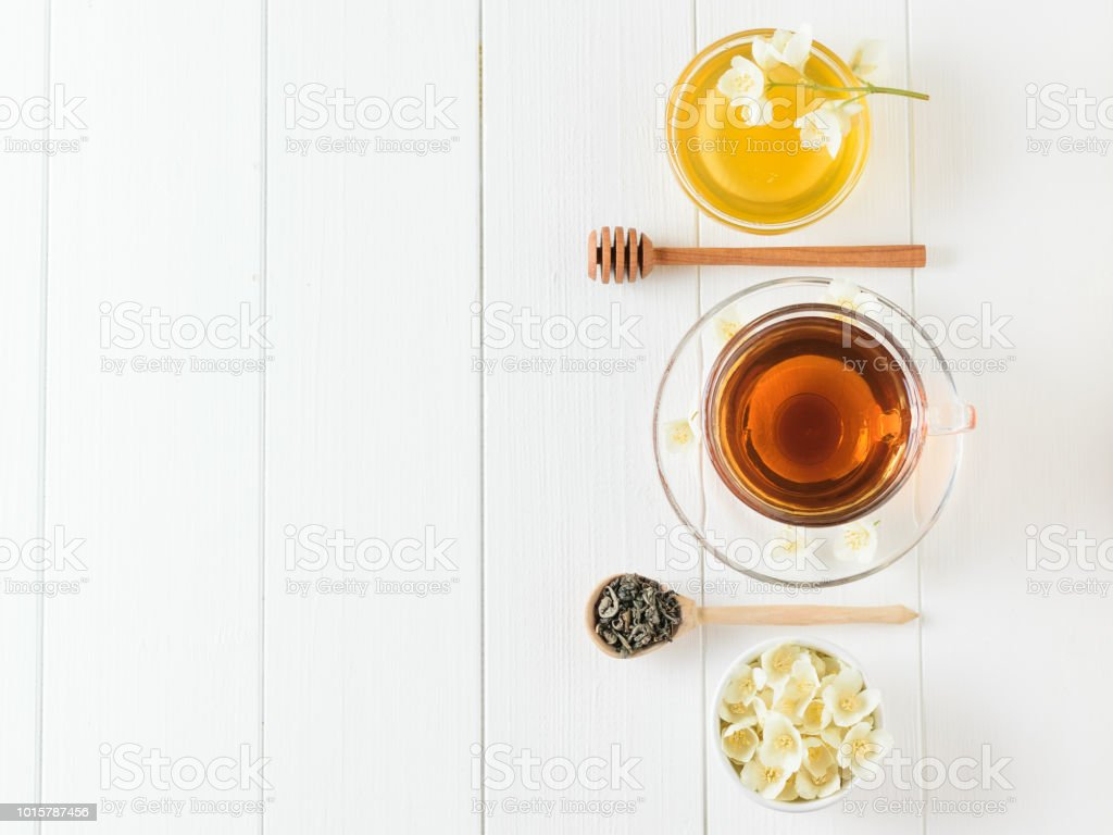 Herbal Tea With Jasmine And A Bowl Of Flowers And Honey On A Rustic