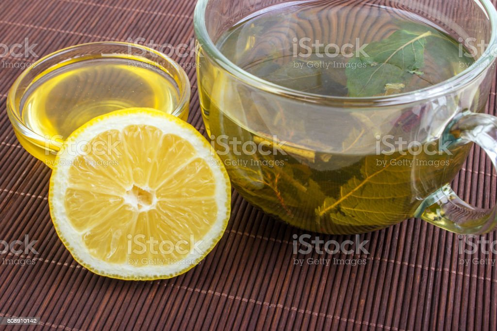 Herbal tea with lemon and honey on the wooden background stock photo