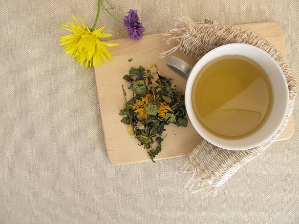 Herbal tea with marigold and cornflower stock photo