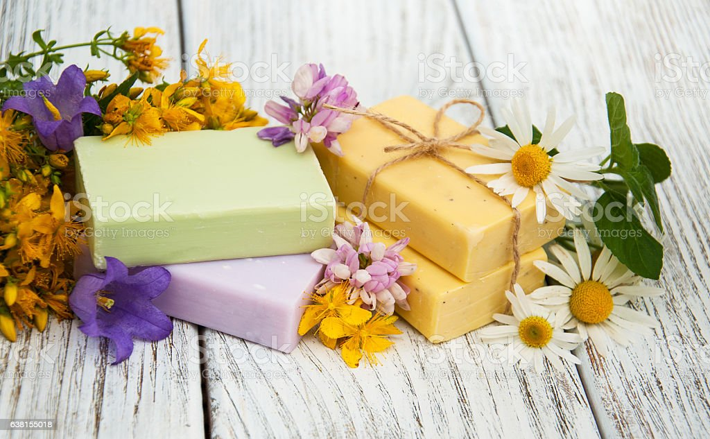 herbal  treatment - camomile, tutsan and soap stock photo