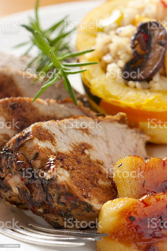 Herb-roasted  Loin of Pork with Apples royalty-free stock photo