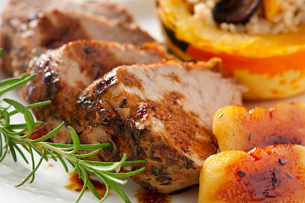 herb-roasted  loin of pork with apples - loin bildbanksfoton och bilder