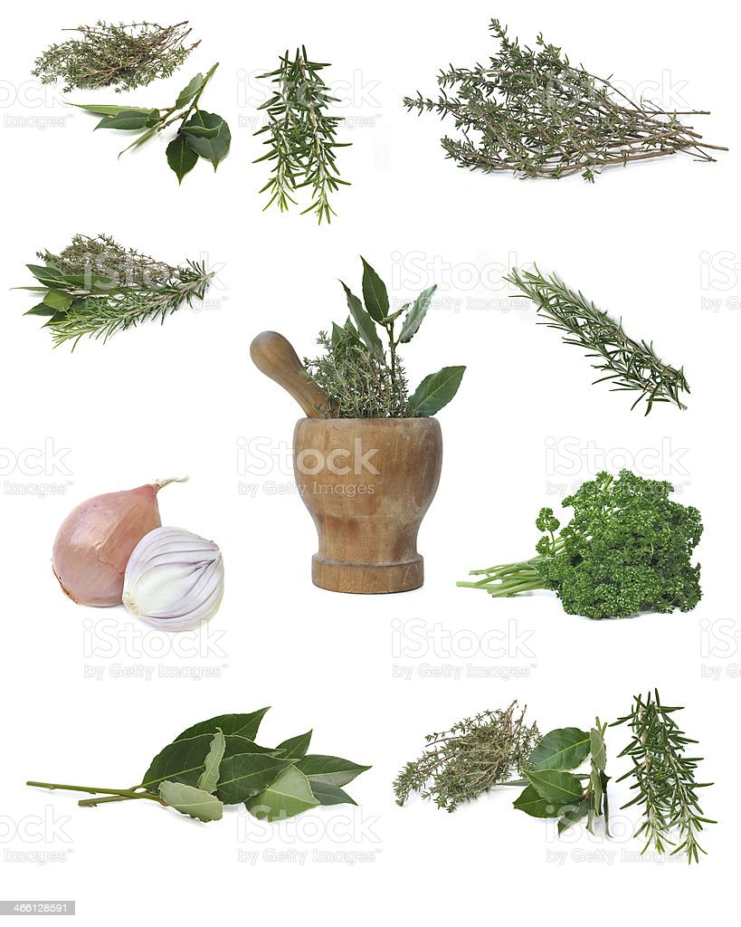 herbs and a wooden pestle stock photo