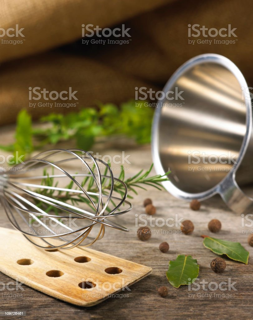 Herbs and cooking utensils royalty-free stock photo