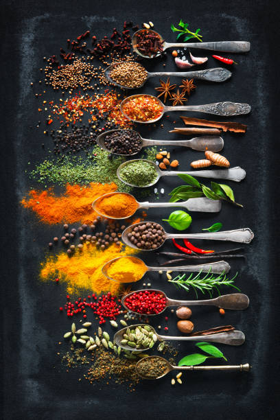 Herbs and spices for cooking on dark background Colourful various herbs and spices for cooking on dark background allspice stock pictures, royalty-free photos & images