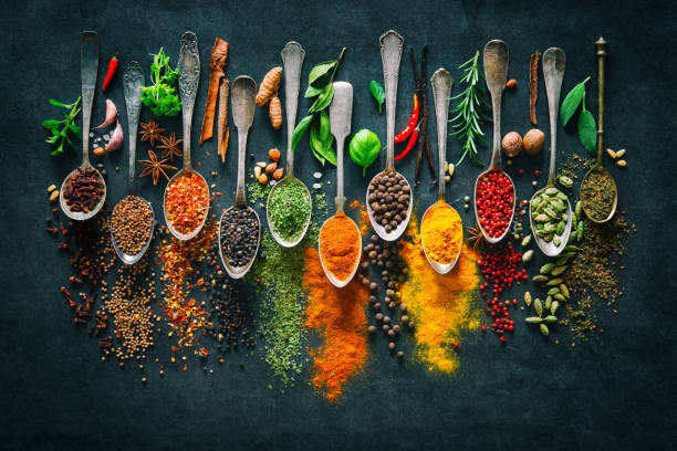 herbs and spices for cooking on dark background - multi colored stock pictures, royalty-free photos & images
