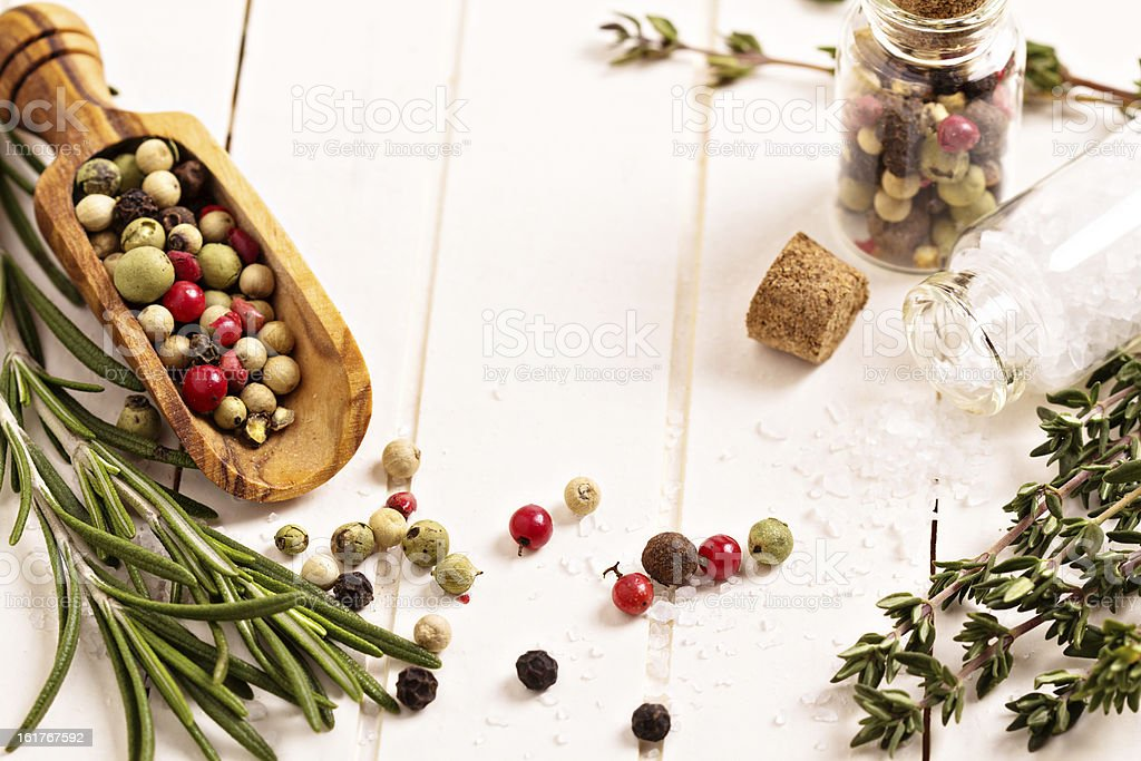 Herbs and spices on a white table royalty-free stock photo
