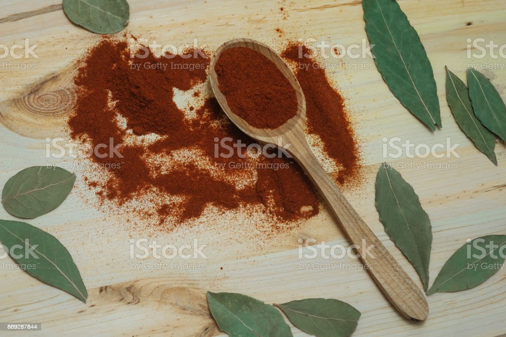 Herbs and spices on a wooden board stock photo