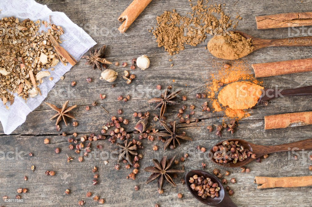 Herbs and spices on a wooden board. Spice spoon stock photo